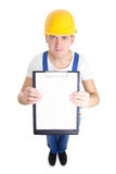 Contract concept - man in builder uniform showing clipboard with Stock Image
