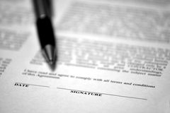 Contract on Desk with Black Pen Royalty Free Stock Photo