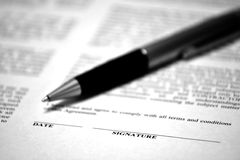 Contract on Desk with Black Pen Royalty Free Stock Images