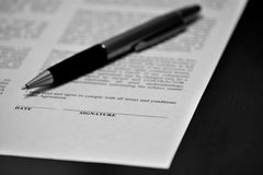 Contract on Desk with Black Pen Stock Image