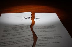 Contract on desk. Torn legal contract on a desk Royalty Free Stock Photo