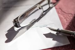 Close-up of Contract form with fountain pen and glasses. Contract form with fountain pen and glasses Stock Image