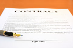 Contract and fountain pen. Contract document and fountain pen. Shallow depth of field, focus on Sign here text Royalty Free Stock Photos