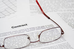 Contract with glasses. On table picture Stock Images