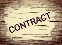 Contract on grunge wood background stock image