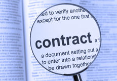 Contract. Highlighted thru a magnifying glass Royalty Free Stock Photos