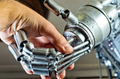 Contract between human and robot Royalty Free Stock Photography