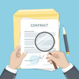 Contract inspection concept. Businessman hands holding magnifying glass over a contract. Contract with signature and stamp. Research documents Royalty Free Stock Photography