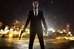 Contract Killer. In the rain royalty free stock photo