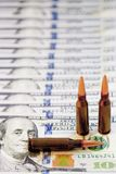 Contract killing and murder for money concept. Bullets on dollar Stock Photography