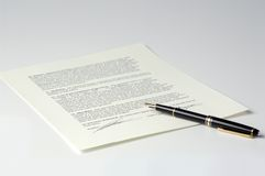 Contract / Legal Agreement. Contract or legal agreement with pen Stock Photography