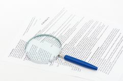 Contract with a magnifying glass Royalty Free Stock Image