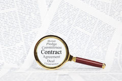Contract and Magnifying Glass Concept Stock Photography