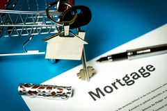 The contract for a mortgage loan. The keys of the property stock images