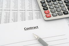 Contract with numbers, calculator and pen Stock Photography