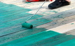 Contract painter painting a floor with green paint Royalty Free Stock Photos