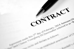Contract on Paper with Black Pen. Written contract on pape with black pen Stock Images
