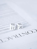 Contract paper with gambling dices Stock Photography