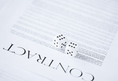 Contract paper with gambling dices Royalty Free Stock Photo