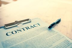 Contract paper with pen on desk. Contract paper with pen on desk Royalty Free Stock Image