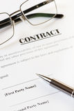 Contract and Pen with Glasses Royalty Free Stock Images