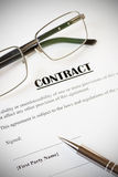 Contract and Pen with Glasses Royalty Free Stock Photography