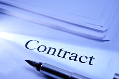 Contract. Pen lying on a document headed Contract conceptual of a legal binding business contract or partnership Royalty Free Stock Photos
