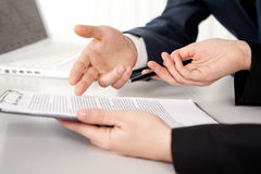 Contract point. Hands of two businesspeople discussing a contract Stock Photo