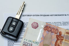 The contract of purchase the car, money and key Stock Image