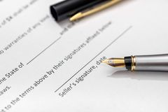 Contract for purchase of car with pen. Marco Royalty Free Stock Images