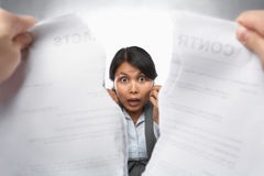 Contract refusal or rejection. With shocked Asian businesswoman as main focus Stock Images