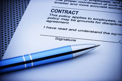 Contract Signature Document. A pen resting on a contract agreement document ready to be signed