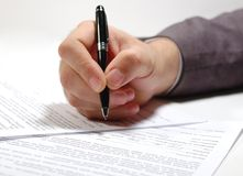 Contract_signing. A businessman signing a contract Royalty Free Stock Images