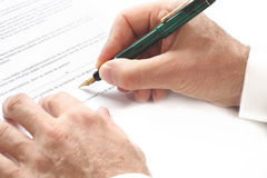 Contract signing hand and pen Royalty Free Stock Photos