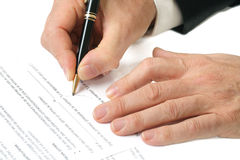 Contract signing hand and pen Royalty Free Stock Photography
