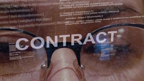 Contract text on background of female developer