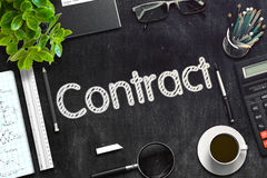 Contract - Text on Black Chalkboard. 3D Rendering. Stock Photo
