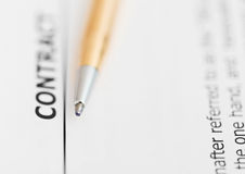Contract and tip of golden pen Royalty Free Stock Images
