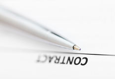 Contract and tip of silver pen Royalty Free Stock Photography