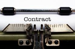 Contract on typewriter Stock Photo