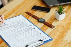 Contract waiting for a notary public sign on desk.  royalty free stock images