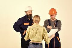 Contract work. Work Abroad. Misunderstanding concept. Brigade of workers, builders in helmets, repairers, lady arguing. Discussing contract, white background Stock Photos