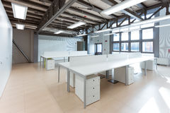Contracted office. Open-plan office housed in a foundry Stock Image