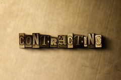 CONTRACTING - close-up of grungy vintage typeset word on metal backdrop. Royalty free stock illustration. Can be used for online banner ads and direct mail stock illustration