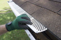 Contractor Adjusting Plastic Gutter Guards Stock Images