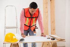 Contractor analyzing a blueprint Royalty Free Stock Photo