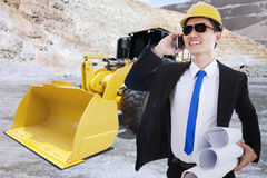 Contractor with backhoe on the background Stock Photography