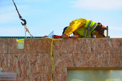 Contractor Building New Modular Frame Plywood Board Panel Walls House on the Building Site. Structural Insulated Panels House Royalty Free Stock Photography