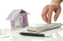 Contractor calculating costs of a house Stock Image