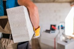 Contractor with Concrete Block Stock Images